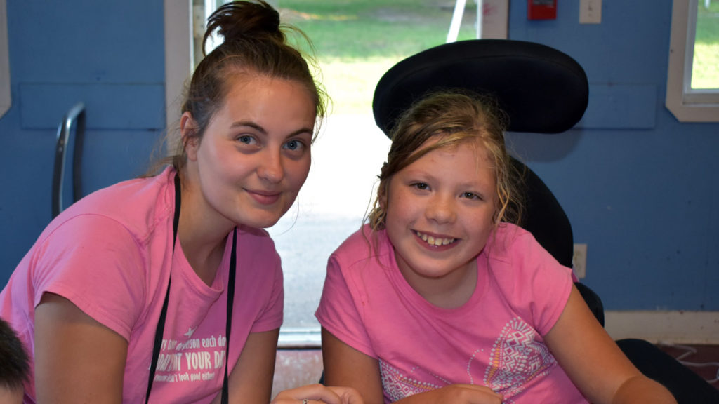 Discovery Camp - A camper and coucilor both wearing pink shirts